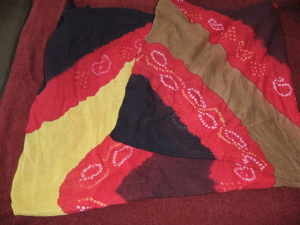#1 headwrap, black, red, yellow, and brown with white tiedyes designs (could also be used as a wrap or cut into a sleevess tunic!
