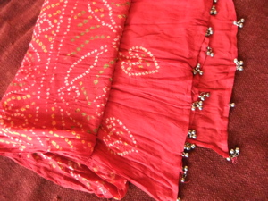 #3 headwrap--Red with white designs, and bells on ends, not new-$15 +$5.50