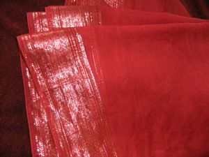 somewhat sheer red with sparkly border, not big eneough for a veil, but looks great as a wrap or pinned to your headwrap and hanging down your back! $20 plus $5.50 s&h