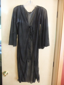 a soft flowing tunic (or sheer coverup), swaying sleeves, black with shiny bits! $25.00 plus $5.50 S&H)